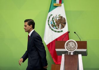 Mexican President Enrique Pena Nieto leaves the podium after speaking during an event to present a national policy on financial inclusion in Mexico, at the National Palace in Mexico City, Tuesday, June 21, 2016. (AP Photo/Rebecca Blackwell)